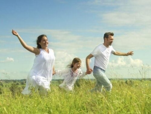 Family running in a meadow