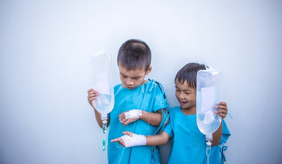 Two children getting medical treatment