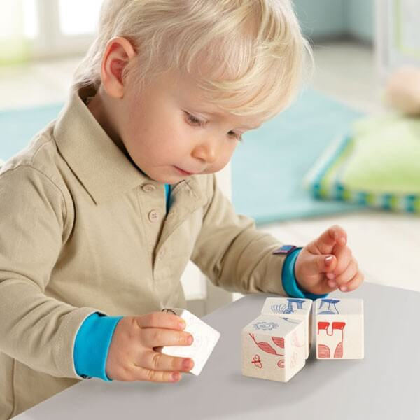 two-year-old boy playing with blocks