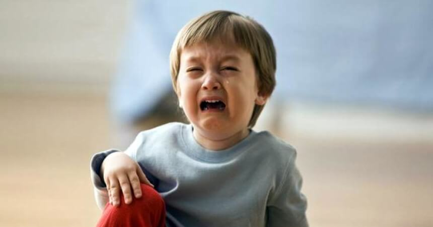 boy crying after hitting his head