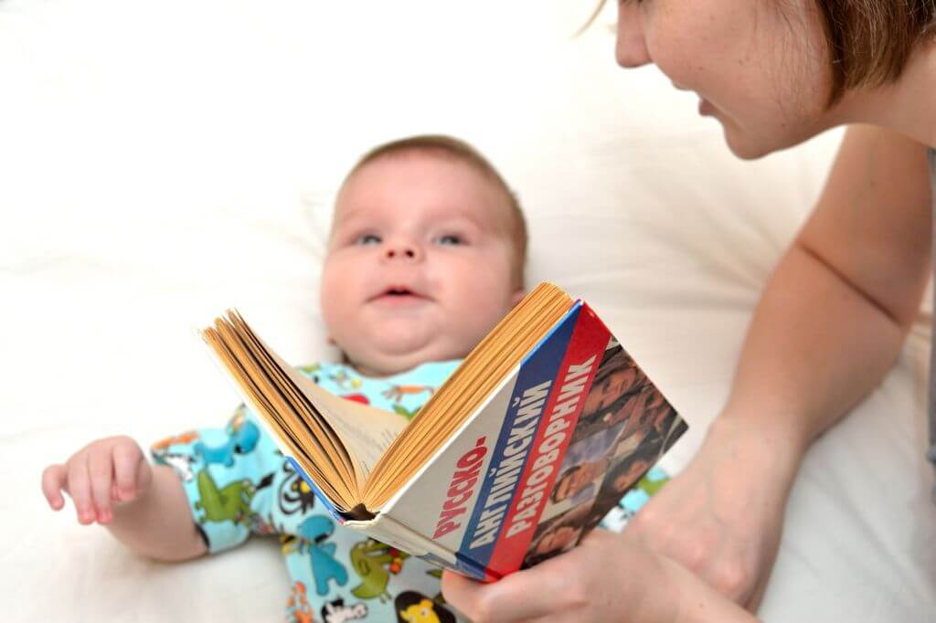 mom reading to baby