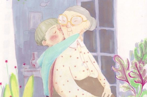 boy kissing grandmother