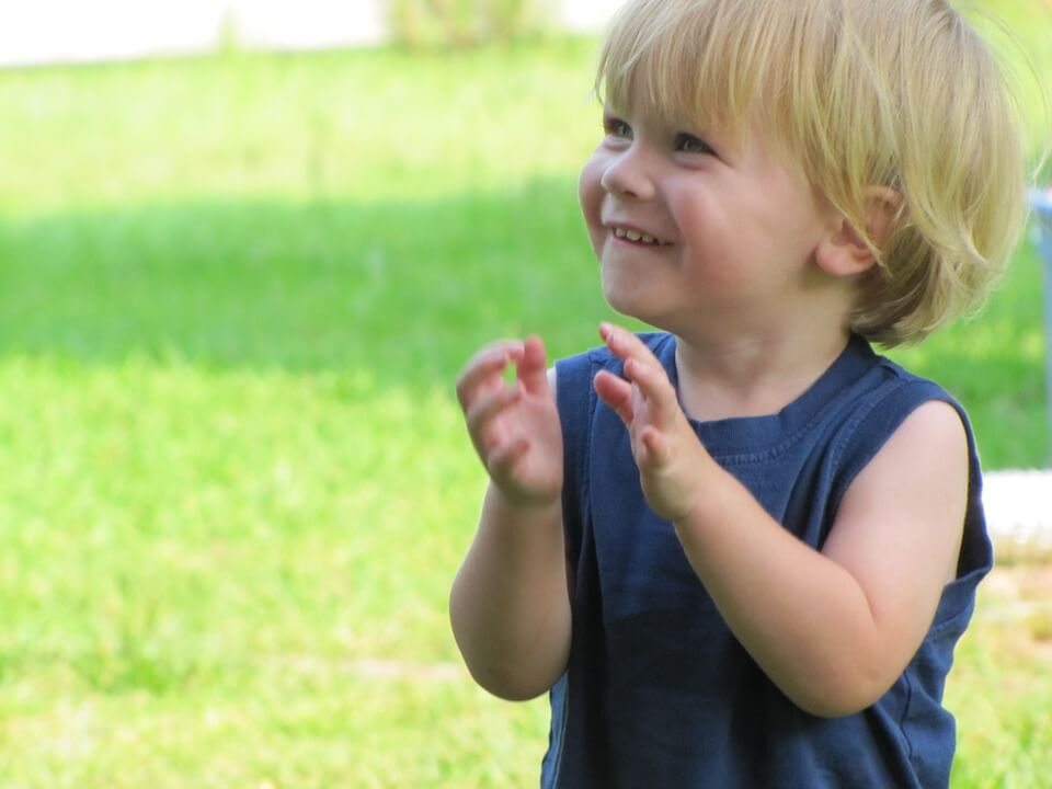 happy baby clapping hands