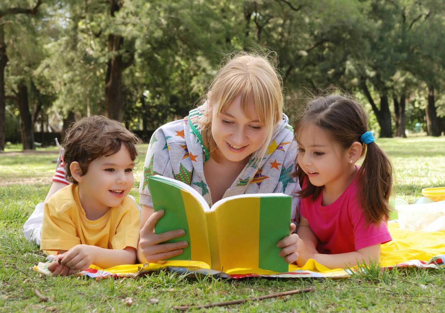 Mother reading books with children