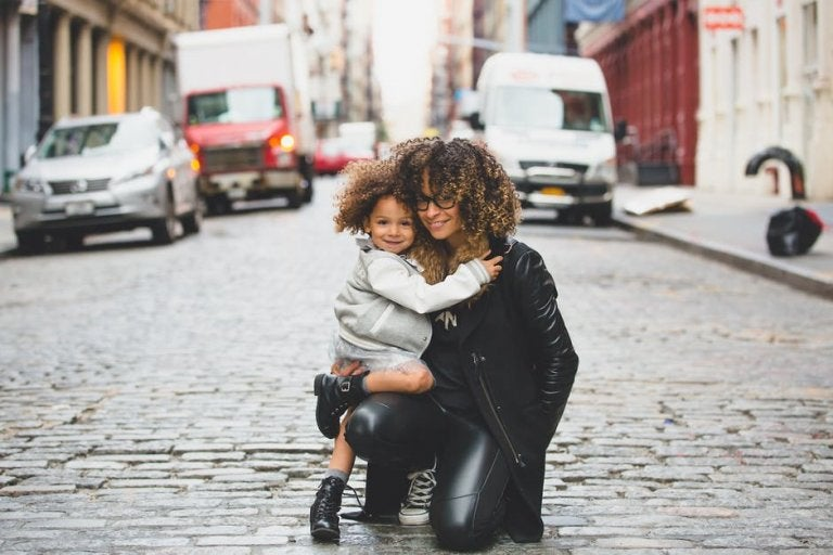 Mom and daughter on a city street