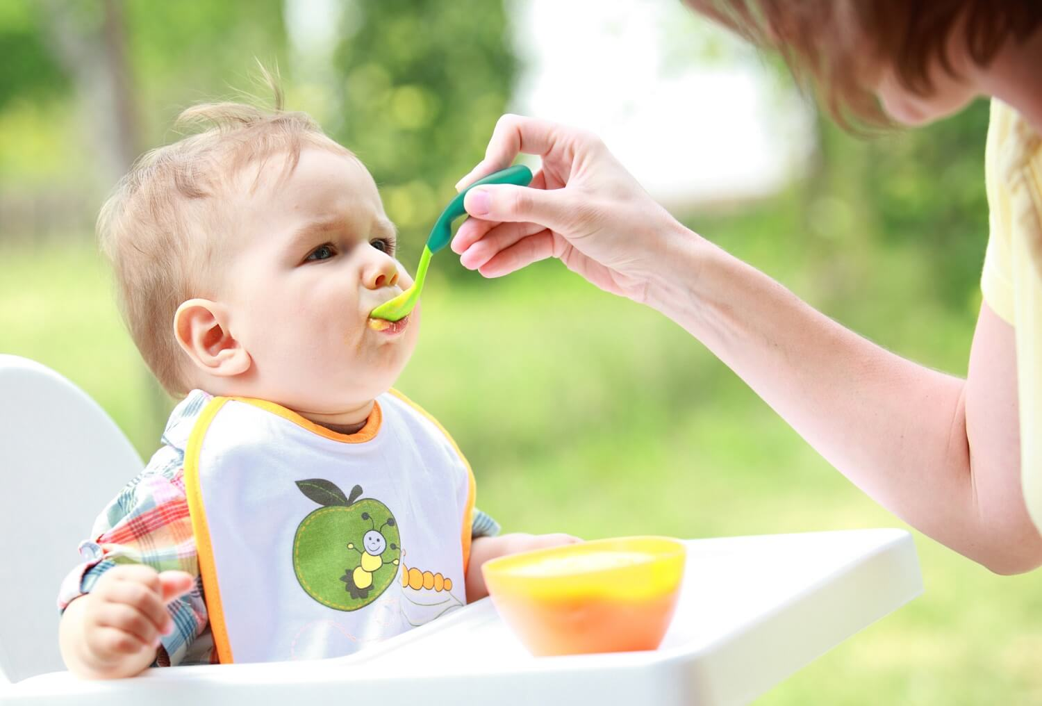 feeding a complimentary diet to a baby