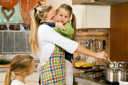 busy mom on the phone and cooking with children