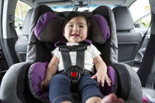 girl sitting in a car seat