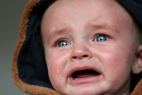 blue eyed baby crying
