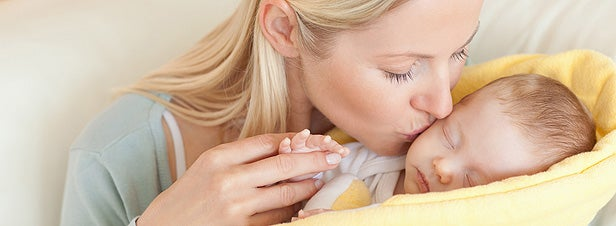 mother taking care of baby with the flu with saline solution
