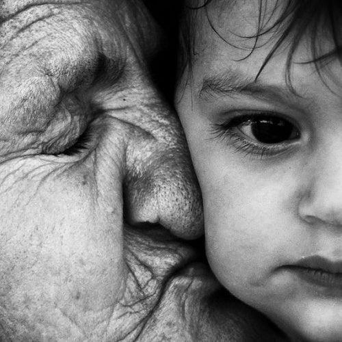 grandmother kissing grandson