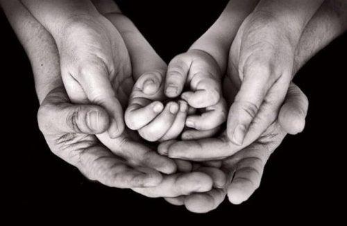 three pairs of hands black and white photo