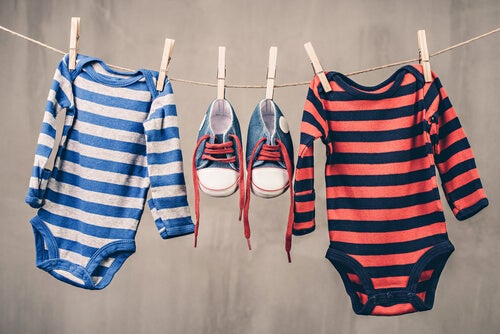 babies clothes and shoes hanging up