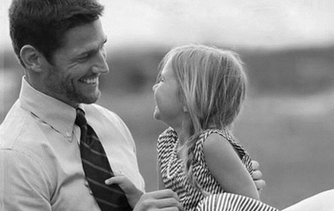 black and white photo of a father and daughter
