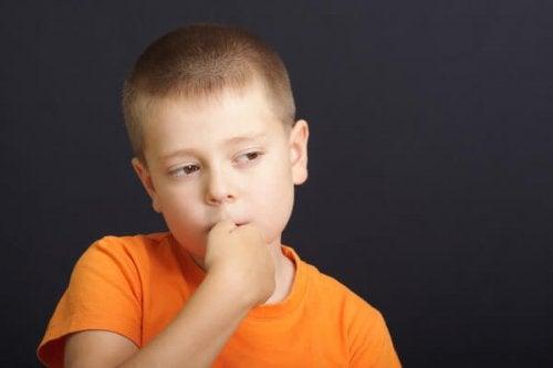 a boy sucking his thumb