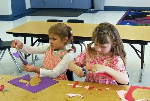 Children using paper to do crafts.