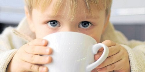 Coffee and children, boy drinking coffee