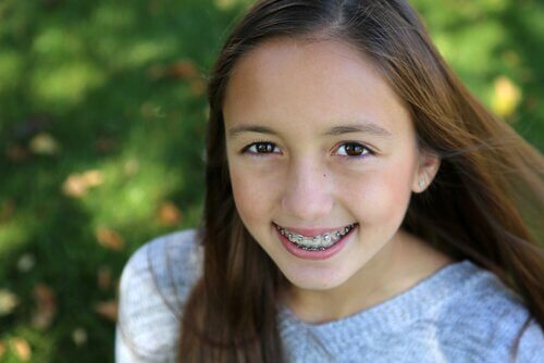 Girl with braces smiling.