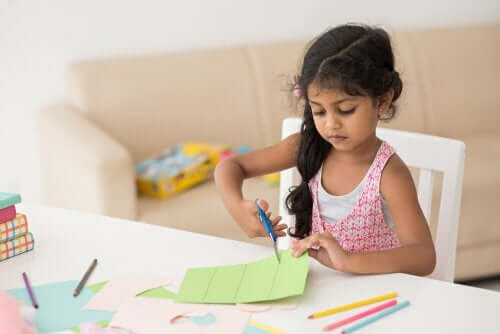 A girl cutting paper.