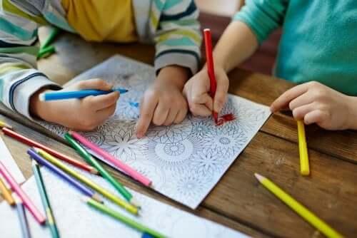 Children coloring mandalas.