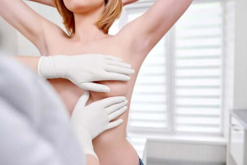A woman getting her breasts examinated.