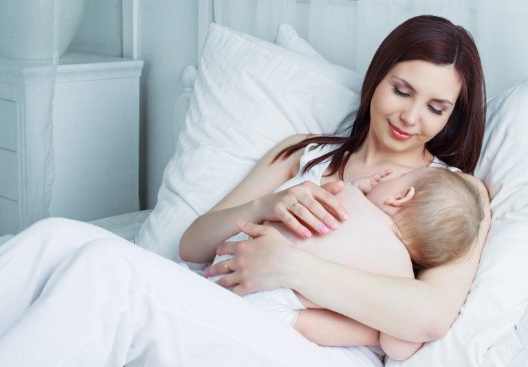 A woman breast feeding.