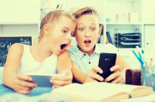 Children watching YouTube videos.