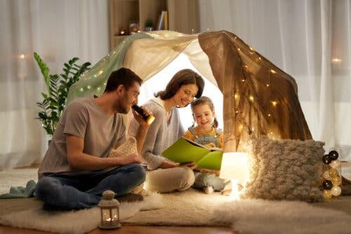 A family reading in a fort.