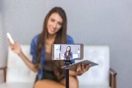 A teen recording a video.