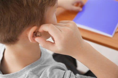 A boy wearing a hearing aid.