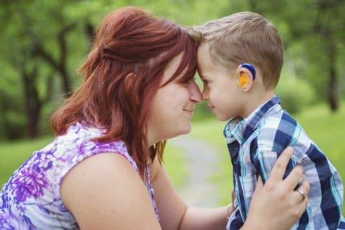A mother with her son who has hearing problems.