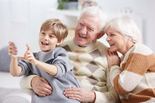 A child taking a selfie with his grandparents.
