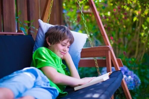 A teen reading personalized story books.