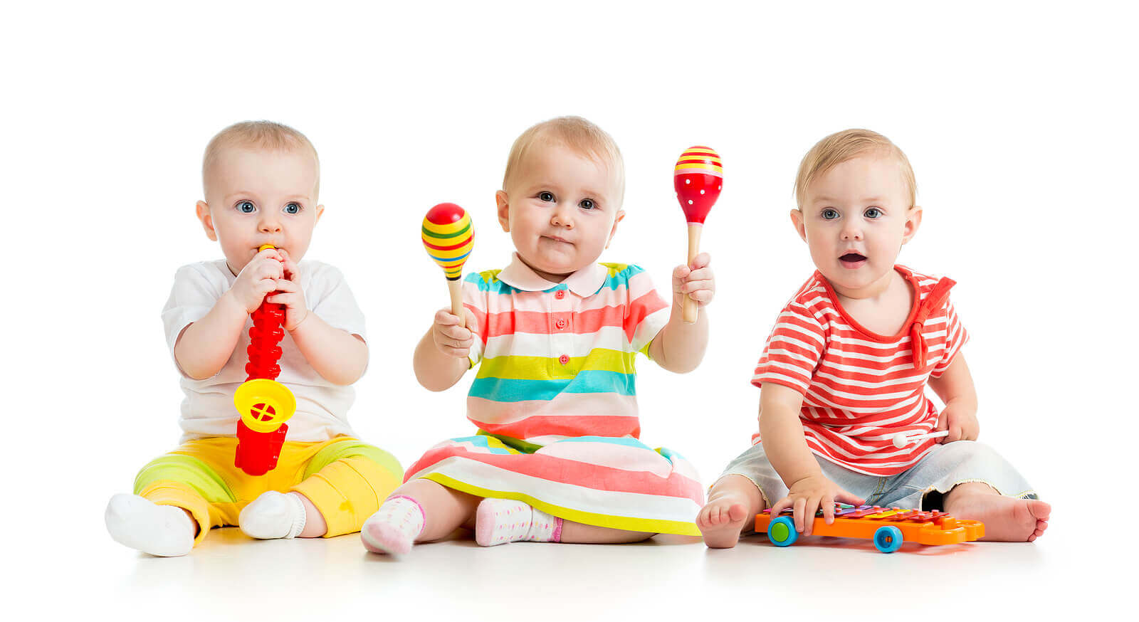 Babies playing musical instruments.