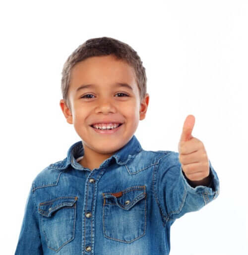 A boy giving a thumbs up.