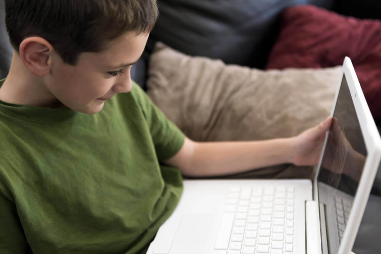 A boy on a laptop.