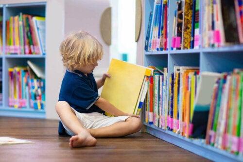 A young boy reading a book.