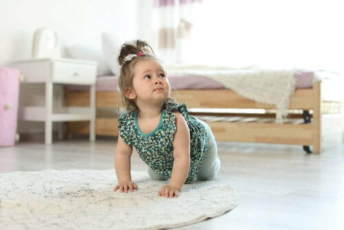 A little girl crawling.