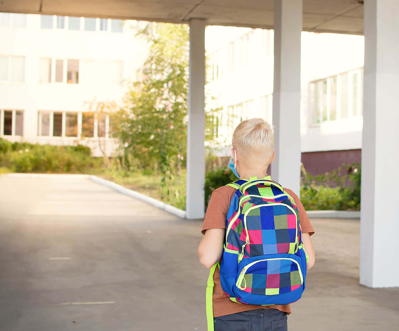A child walking into a new school.