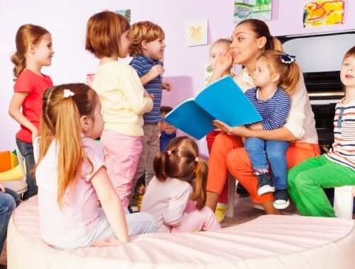 A teacher reading a story to a group of preschoolers.