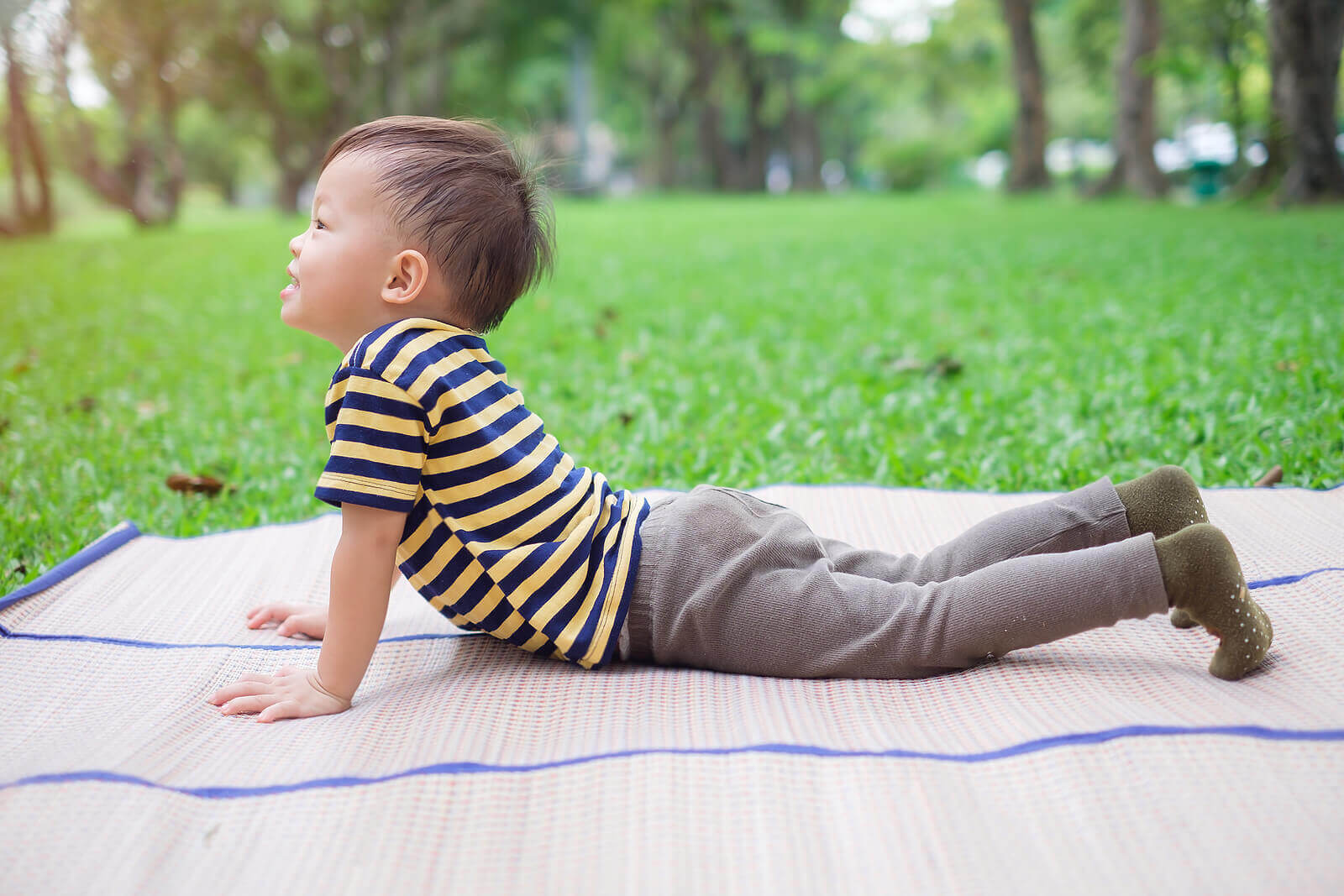 Child doing a cobra pose in yoga