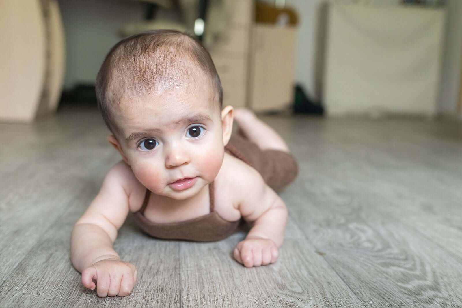 Baby starting to crawl.
