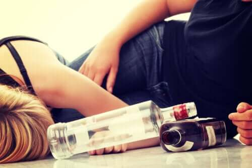 Teenagers lying on the floor drunk after drinking alcohol.
