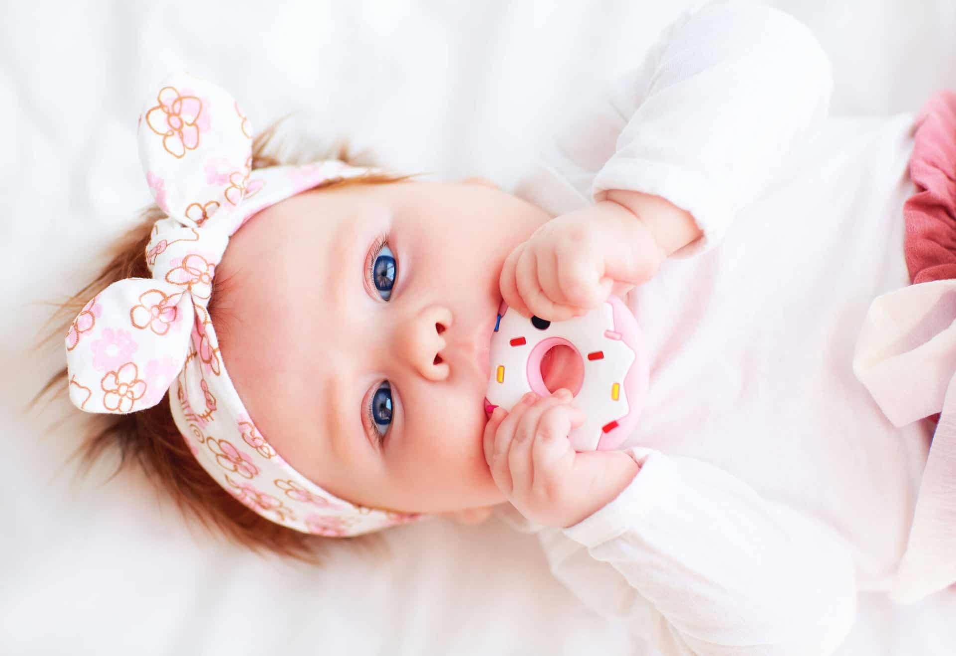 Baby with teether.