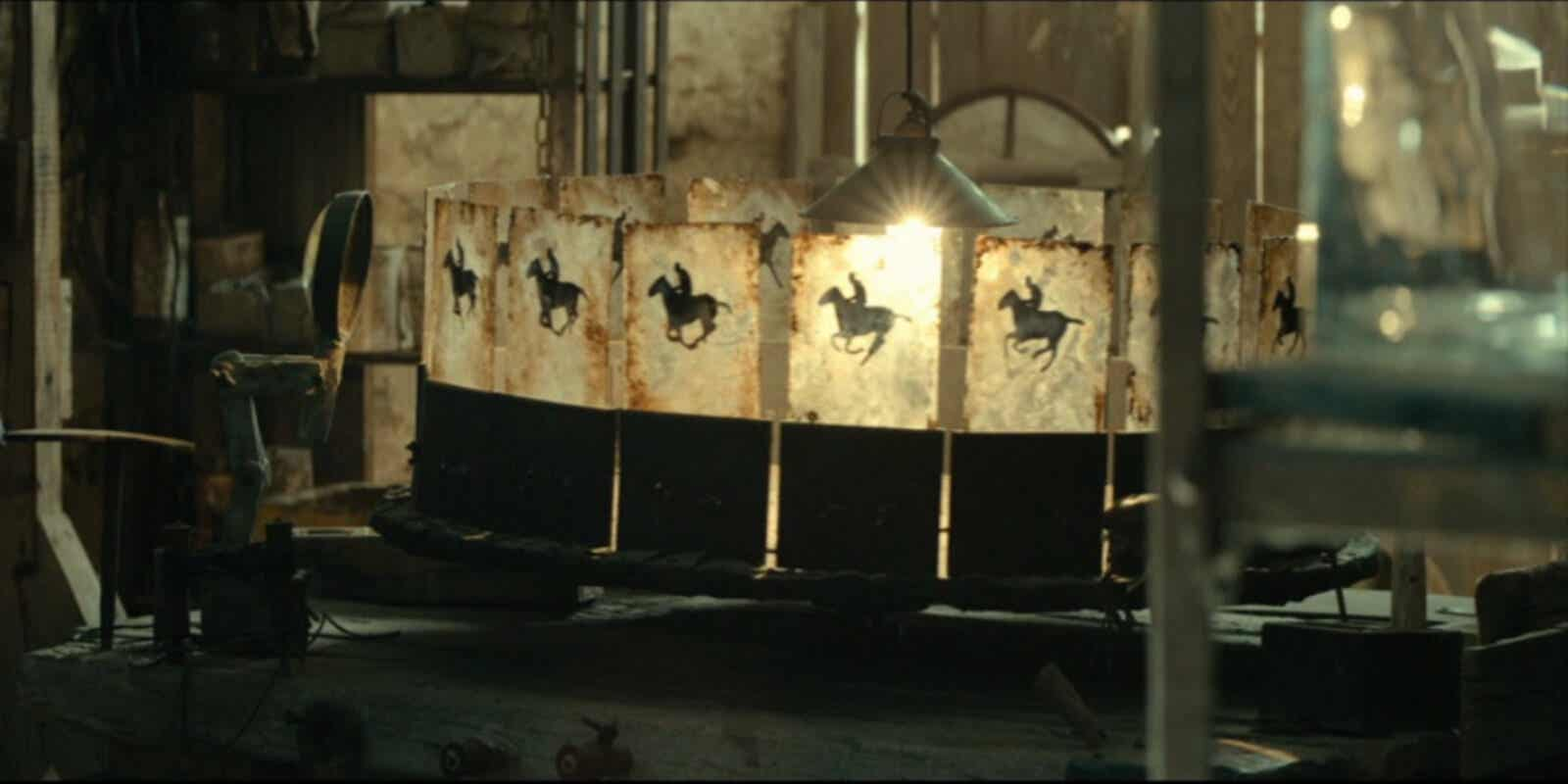 A zoetrope showing a horse and rider.