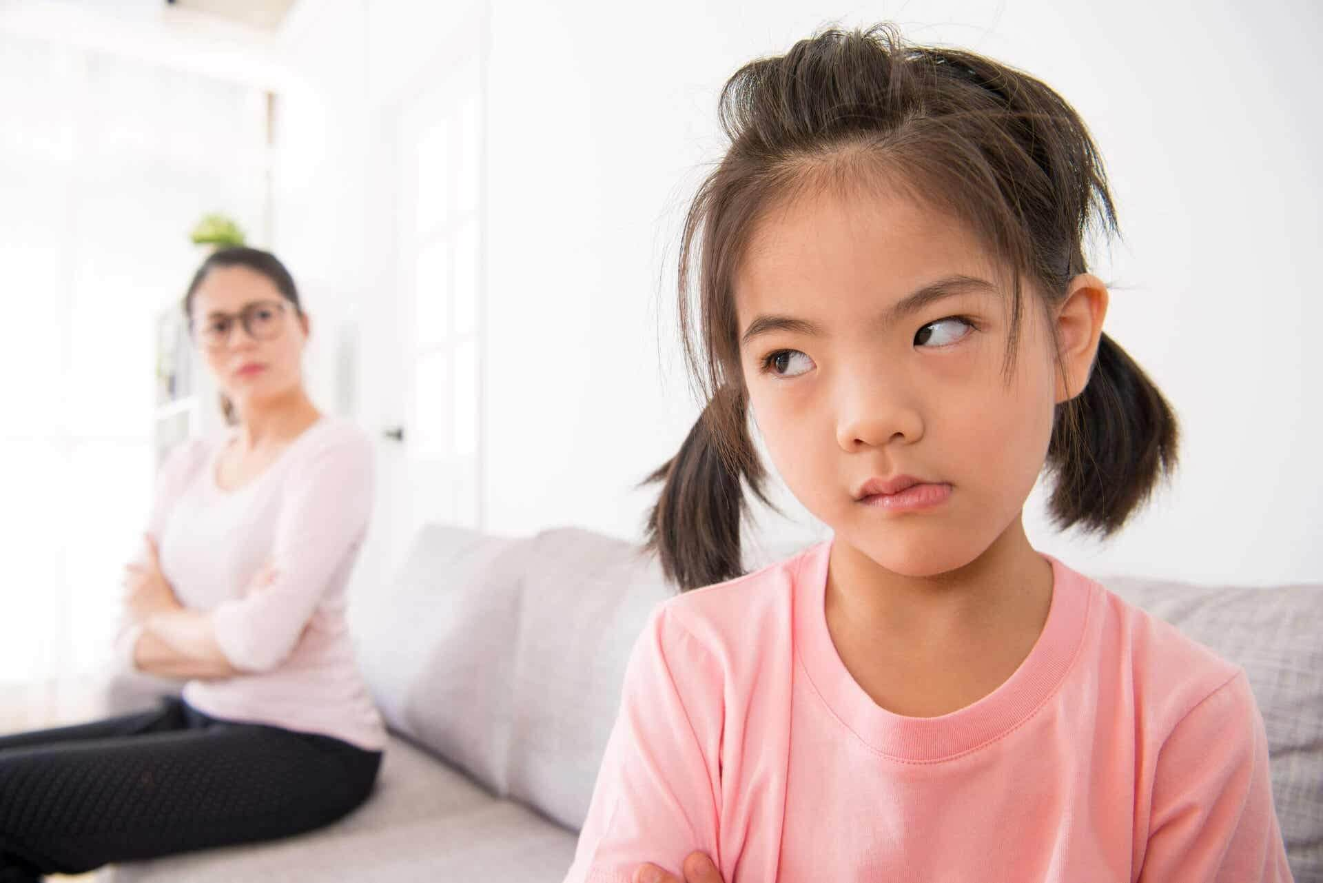 Girl very angry with her mother, she doesn't want to give her a hug.