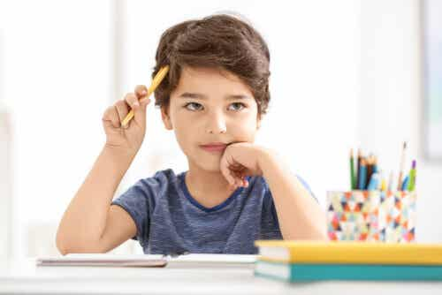 A child that's daydreaming while doing his homework.