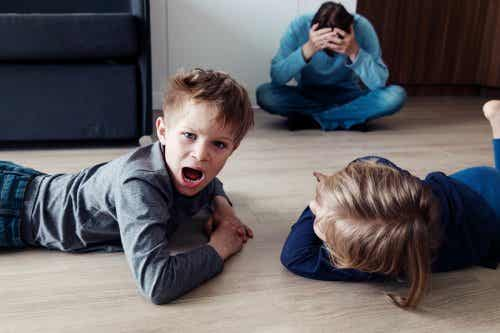 A father feeling frustrated because his children won't obey. Three to six-year-olds