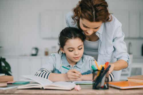 A mother helping her daughter study.