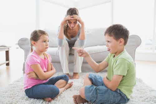 A mother feeling overwhelmed by her children's arguments.